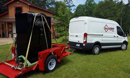 van towing a large safe